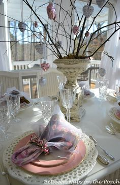 Romantic Valentine's Day Tablescapes Table Settings with a Mercury-glass Heart Tree Centerpiece  I am creating a tree with hanging hearts with hearts cut from old book pages for my mantle! Love this from naps on the porch!