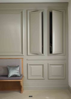 Wall panneling with concealed storage by McCarron & Co
