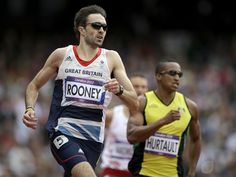 Britain's Martyn Rooney and Dominica's Erison Hurtault compete in a men's 400-meter heat during the athletics in the Olympic Stadium.