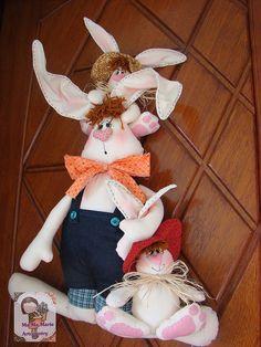Papai coelho  e seus filhotinhos...