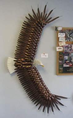 Eagle sculpture made from silverware by Dangerous Arts