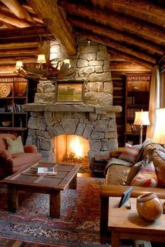I love this rustic living room. I want a cabin in the mountains with this room in it. Especially that fireplace!