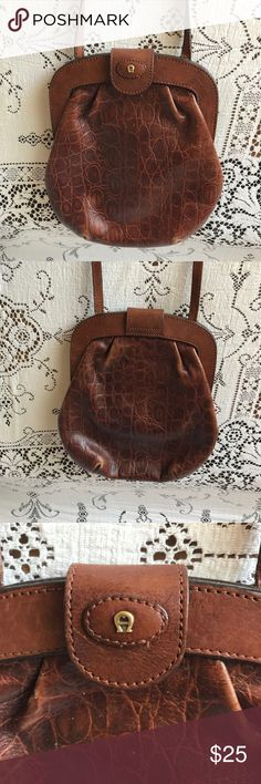 "Vintage Etienne Aigner Crossbody Adorable little Vintage Etienne Aigner Crossbody purse. Faint signs of wear seen in corners. Deep camel brown with gold hardware. Clean interior. Faux gator print 🐊  spacious enough to hold all of the essentials. 8.5"" tall 7.5"" wide  27"" drop length Etienne Aigner Bags Crossbody Bags"