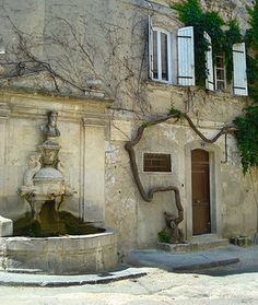 St-Remy-de-Provence, Nostradamus Fountain | Probably the most famous native son of St-Remy, 16th century philosopher Nostradamus, is honored by this fountain in the old quarter. Van Gogh also painted around 150 canvases of the town and its surroundings during his stay during 1889-1890 at the Asylum of Saint-Paul-de-Mausole.