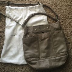Marc by Marc Jacobs Handbag!!! Great crossbody Marc by Marc Jacobs handbag. The handle also has some wear to them. It has been used and is not in perfect condition, but it still has a lot of life left in! It needs a new home!! Marc by Marc Jacobs Bags Crossbody Bags