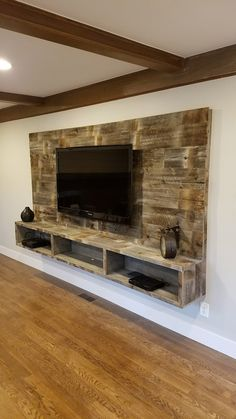 Wood Wall with Floating Entertainment Shelf Board Bolt Floating Shelves Entertainment Center, Home Entertainment Centers, Floating Entertainment Unit, Floating Tv Shelf, Custom Entertainment Center, Entertainment Products, Deco Tv, Living Room Tv Unit Designs, Tv Wall Decor