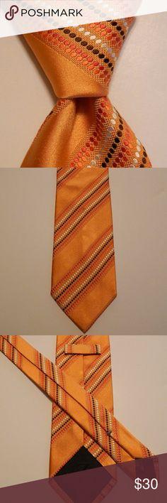 "ERMENEGILDO ZEGNA Silk Necktie STRIPED Orange EUC ERMENEGILDO ZEGNA Men's 100% Silk Necktie ITALY Luxury Thick STRIPED Orange EUC  ·        Brand: Ermenegildo Zegna ·        Style: Neck Tie ·        Color: Orange/Brown/White ·        Material:100% Silk ·        Attachment: Tied ·        Length: Classic 58"" ·        Width: Skinny 3 3/8"" ·        Pattern: Striped ·        Country/Region of Manufacturer: Italy ·        Condition: Excellent Used Condition Ermenegildo Zegna Accessories Ties"