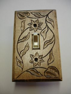 Electric switch cover plate hand carved by creativemind44 on Etsy, $22.00