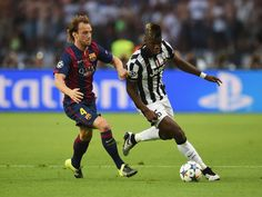 Paul Pogba of Juventus is tackled by Ivan Rakitic of Barcelona during the UEFA Champions League Final between Juventus and FC Barcelona at Olympiastadion on June 6, 2015 in Berlin, Germany.