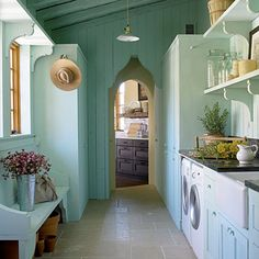 """A soft blue """"dream room"""" for arranging flowers and handling laundry."""