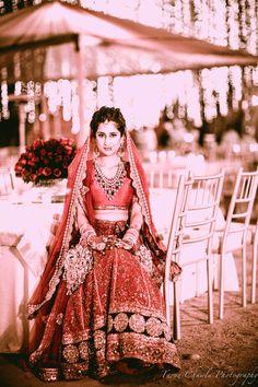 Tarun Chawla Photography, red threadwork lehenga, plain blouse, chunky layered necklace, light modern red lehenga