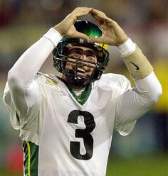 Joey Harrington celebrates after one of his four touchdown passes in the 2002 Fiesta Bowl, leading the Ducks past Colorado, 38-16, and to their first BCS bowl victory.