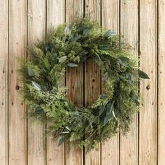 A full mix of texture and seasonal greenery that works from fall through Christmas, year after year. Our Cypress and Eucalyptus Wreath is hand finished with natural looking eucalyptus leaves intertwined in lacy cypress branches.