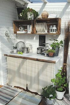 Love these crates adhered to the wall. I have a collection of boxes that would be perfect for this. coffee bar.....love it!