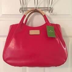 Kate Spade Fulton Street Red Tote Bag Large.  CoTed bag.  Leather trim.  Snap closure.  3 interior pockets (1 zips).  NWT.  Measures: 13.5x5x9x4.5. kate spade Bags Totes