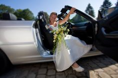 The bride poses in their BMW cabriolet after arriving on location for the picture session with the couple.    Best Viewed On Black    Check out my blog    Copyright ©2008 indigo2 photography and Paul Indigo.   All rights reserved.  www.indigo2photography.co. 1