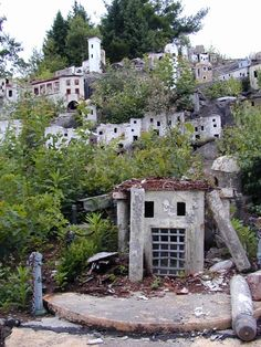 Holy Land USA, a long-shuttered, Bible-themed amusement park containing a modest replica of Bethlehem. The park, which opened in the 1950s and closed in the 1980s, is now decrepit and overgrown, its buildings graffitied and falling down.