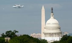Discovery in flight over Washington. Photograph: Kevin Lamarque/Reuters