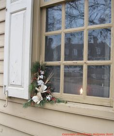 Christmas in Colonial Williamsburg, 2012: A decorated house window. More: http://twonerdyhistorygirls.blogspot.com/2012/12/day-i-christmas-in-colonial.html
