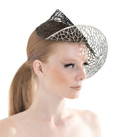 Headpiece by Aniss - these structural/architectural hats are interesting and I could see them being done with beads and other found elements.