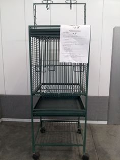 """Cage #5 - AVAILABLE - 18""""x18""""x19"""" inside,  B/S ½""""; one piece stand/cage/playtop; green, 53"""" to top of playstand; needs cleaning."""