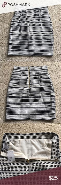H&M Skirt Black and white A-Line/pencil skirt with black buttons and golden zipper on the back. Runs small. Never been worn. H&M Skirts