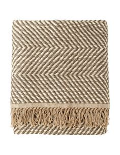 rustic hand-woven jute rug - looks lush enough to be a blanket or a shawl