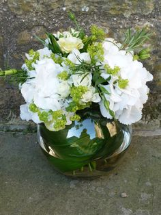Fishbowl arrangement of hydrangeas and roses
