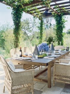 In the garden of a dreamy Southern California home, a remarkable long wooden table by Axel Vervoordt sits under a vine-covered pergola. Zinc sculptures add an architectural element to the table. Click through for more design inspiration for luxe outdoor dining areas. We promise they'll live you wanting to dine alfresco every night for the rest of the summer.
