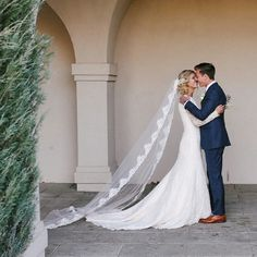modest wedding dress with long lace sleeves from alta moda on a Seattle, WA bride.       --    photo: mandi nelson