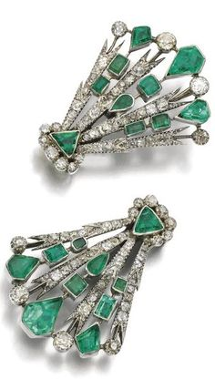 Emerald and diamond double clip brooch, late 19th - early 20th century, composite. Each clip of radiating design set with foil backed mixed cut emeralds and cushion-shaped, circular-cut and rose diamonds, detachable brooch pin. ~ETS #artdeco