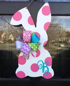 Celebrate Spring and Easter with this hot pink monogrammed bunny wooden door hanger. Sealed with a weather proof topcoat. Contact us with monogram.