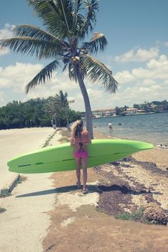 girl walking with paddle board