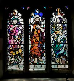 St Dorothea, St Benedict and an Angel, three-light window with standing figures by Leonard Walker, c. 1922, Church of St Cynon, Tregynon, Powys.