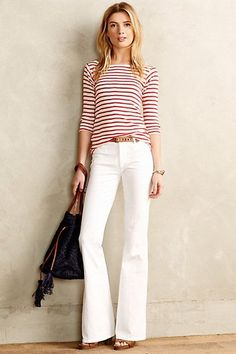 Simple and casual. Clean lines; this flare will enhance her slenderness. Red is good for Kris.