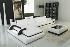 modern living room white leather sectional with black accents black glass top table with white bonded leather light grey area rug white floors of Be Simple yet Modern with These Black and White Living Room Sets White Leather Sofas, Best Leather Sofa, Leather Sectional Sofas, Modern Sectional, Black Leather, White Sectional, Sectional Bed, Modern Couch, Leather Lounge