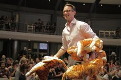Chuck Palahniuk, one of my favourite authors of all time, handing out stuffed tigers at a reading. He is seriously one of the coolest & nicest people I've ever met.