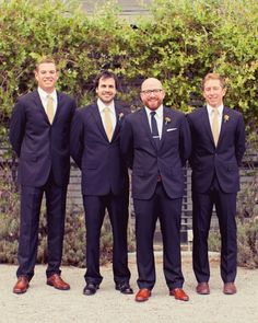 These groomsmen are sporting navy J.Crew suits and khaki ties