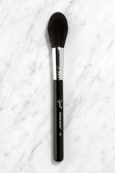 "For shoe lovers it's footwear, and for beauty lovers, it's all about brushes like the Sigma F37 Spotlight Duster Brush! This extremely soft, synthetic-bristle brush has a fluffy, tapered head that's designed to apply powder, highlighter, or bronzer with a light and airy touch. 7.5"" long."