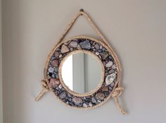 This listing is for a 14 round wall decor mirror framed in beach stone and rustic rope. This is a made to order item and will differ slightly from