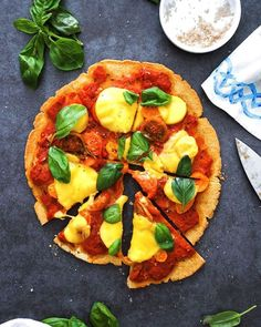 Heirloom tomato chickpea base pizza by @anettvelsberg makes 1 big pizza total time: 45 minutes Ingredients 1 cup chickpea flour 1/2 cup buckwheat flour 1/2 cup tapioca flour 1/2 tsp salt 1 tsbp olive oil + more fro drizzling 1/2 cup cold water 150 ml chopped tomatoes 2 garlic cloves, minced 1 tsp oregano 1/2 tsp thyme 1/2 tsp Worcestershire sauce 1/4 tsp Tabasco salt pepper 100 gr heirloom tomatoes, roughly chopped 70g vegan cheese, thinly sliced fresh basil, to serve Method To make the…