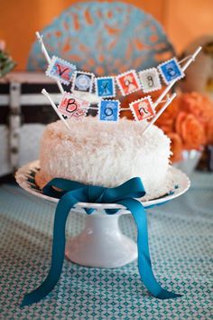 Bon Voyage cake topper bunting on stamps. Photo by Binita Patel and styled by GracieLouEvents.com