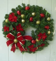 You cant go wrong with a tried and true traditional Christmas wreath. Red and gold multi styled shatter resistant ornaments are complimented by red
