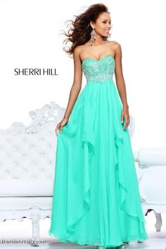 Sherri Hill 3874  Feel like a princess on prom night with this enchanting formal dress by Sherri Hill for prom. This strapless dress with beautiful beaded embellishments will catch the eyes of all onlookers . The sweetheart bodice is brilliantly beaded to the empire waist as  layers of sheer chiffon flow from in soft layers of asymmetrical chiffon. This Sherri Hill dress truly is enchanting making it a must have for your next formal event or any event year round.