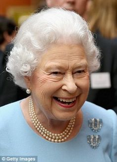 The Queen wore a powder-blue dress and matching aquamarine clip brooches for the Buckingham Palace awards ceremony.