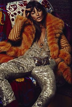Rockstar look: Smokey eye makeup, bed-head, orange fur jacket, and a gold jumpsuit // Lily Aldridge shot by David Roemer for S Moda