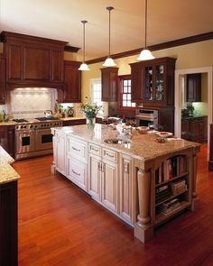 I'd love this if the wood on the island matched the rest of the cabinets.