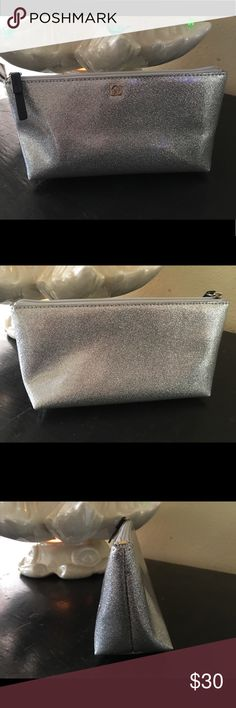 """Kate spade metallic silver glitter cosmetic pouch This is a gorgeous pouch by Kate spade! It is a beautiful silver shimmer glitter bag and is brand new without tags. Will make a great gift! Inside has a unzipped pocket. Measures 8"""" x 4"""" x 2 1/2"""". D kate spade Bags Cosmetic Bags & Cases"""