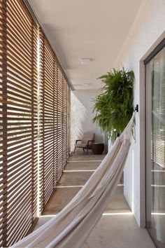 Casa Aguas Claras | Estela Netto Architecture & Design (I like wood slat walls)