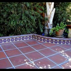 Stonelight Tile - San Jose, CA, United States. Courtyard with quarry tile and S&S 1920's original molds, reissued by Stonelight tiles San Jose Showroom